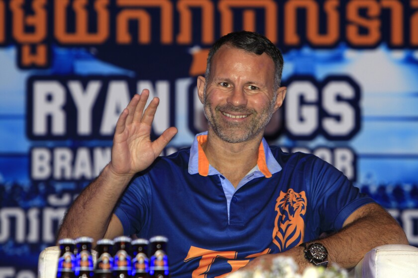 FILE - In this file photo dated Saturday, March 10, 2018, Wales soccer team coach and former Manchester United soccer player Ryan Giggs during a press conference, in Phnom Penh, Cambodia, Saturday, March 10, 2018. The 47-year old Giggs has been charged with assaulting two women, Friday April 23, 2021, and ordered to appear in court on upcoming Wednesday. (AP Photo/Heng Sinith, FILE)