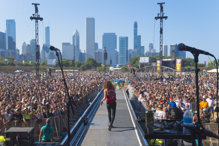 FILE - In this Aug. 4, 2019 file photo, David Shaw of The Revivalists performs on day four of Lollapalooza in Grant Park. The hordes of people expected to descend on Chicago's Grant Park for the Lollapalooza music festival starting Thursday, July 29, 2021, will be required to show proof that they've been vaccinated for COVID-19 or tested negative for the disease within the last three days. (Photo by Amy Harris/Invision/AP File)