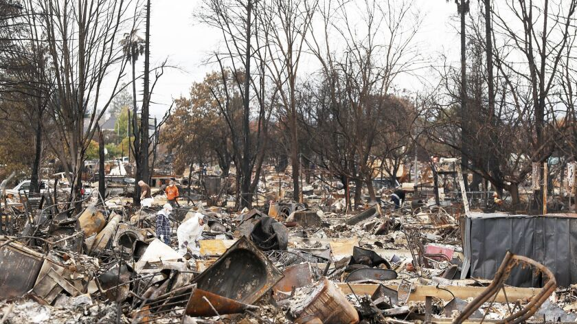 Residents search for salvageable items amid total devastation caused by the Tubbs fire in October 2017.