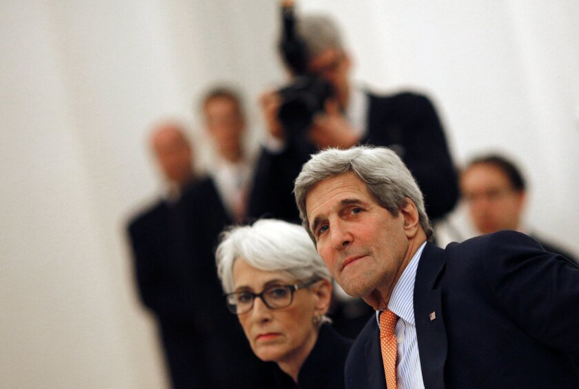 U.S. Secretary of State John F. Kerry and Undersecretary of State Wendy Sherman meet with foreign ministers at a hotel in Vienna on Tuesday to discuss Iran's nuclear program.