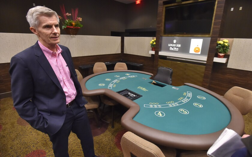 FILE - In this Wednesday, Jan. 25, 2017 file photo,Keith Sharp, general counsel at the Gardens Casino, stands by one of the VIP pai gow tables in Hawaiian Gardens, Calif. Hawaiian Gardens, California's second-largest card room is paying state and federal regulators nearly $6 million for misleading gambling regulators and failing to do enough to deter money laundering, the state's attorney general said Thursday, Dec. 5, 2019. (Scott Varley/The Orange County Register via AP, File)