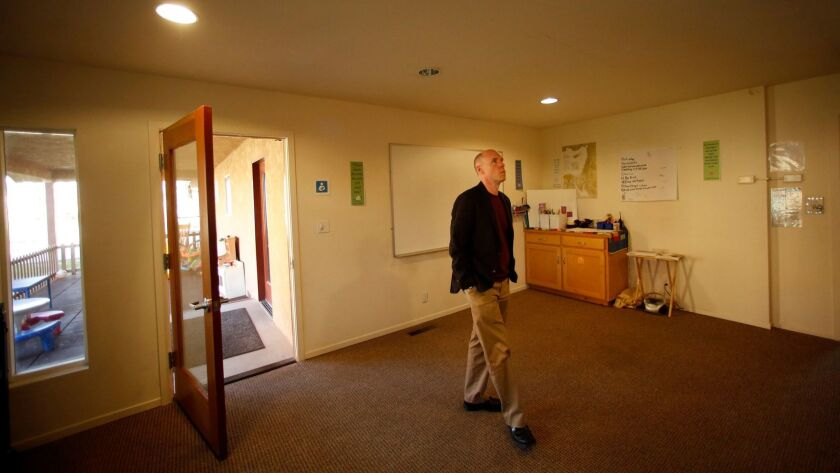 The Rev. Tim Kutzmark of the Unitarian Universalist Church of Fresno walks through a room at the church that will be offered as sanctuary to an undocumented individual or family if members approve.
