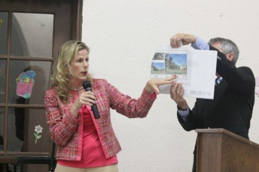AT&T representative Debra DePratti notes the location of a proposed cell tower in Cliffridge Park.