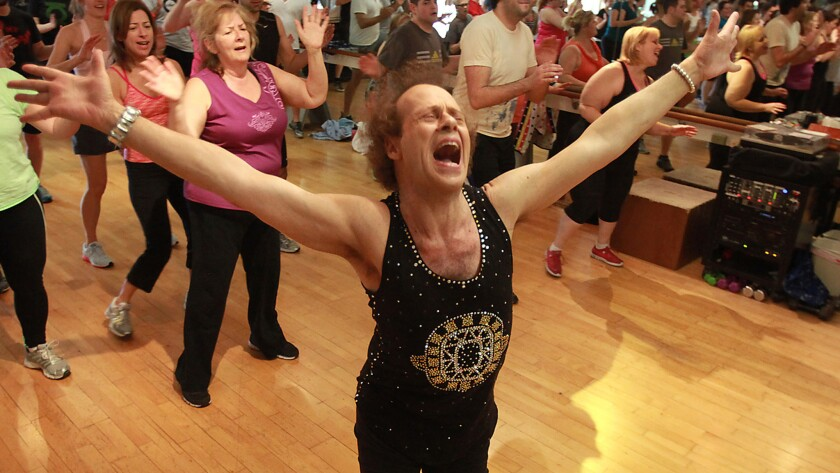 Richard Simmons sings along with the music as he teaches a class in Beverly Hills in 2013.