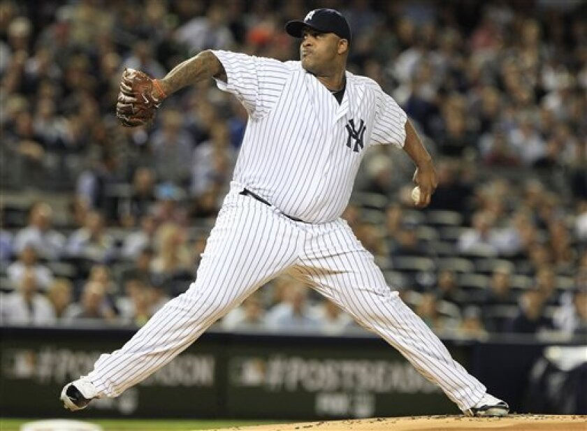 New York Yankees' CC Sabathia delivers a pitch during the first inning of a baseball game against the Detroit Tigers during Game 1 of baseball's American League division series, Friday, Sept. 30, 2011, at Yankee Stadium in New York. (AP Photo/Frank Franklin II)