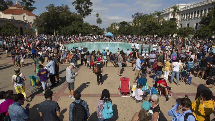 More than 1,000 people gathered outside around Balboa Park's Bea Evenson Fountain in August to watch the partial solar eclipse.