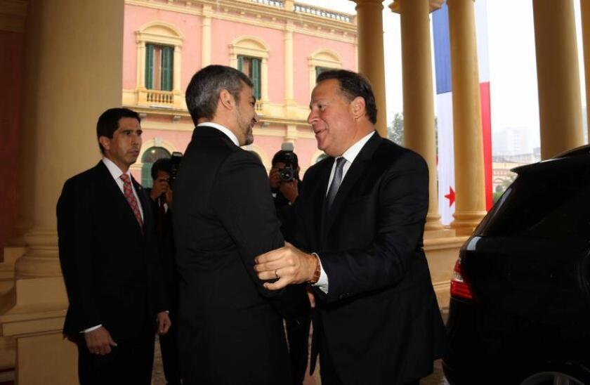 Paraguay's Presidente Mario Abdo Benitez (L) receives his counterpart of Panama Juan Carlos Varela (R) at his arrival to the Government Palace in Asuncion, Paraguay, on Feb. 14, 2019. EPA-EFE/Andres Cristaldo