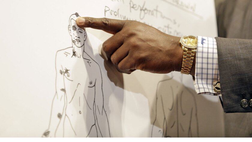 An attorney points to a diagram from a private autopsy on Michael Brown, who was shot and killed by police in August 2014.