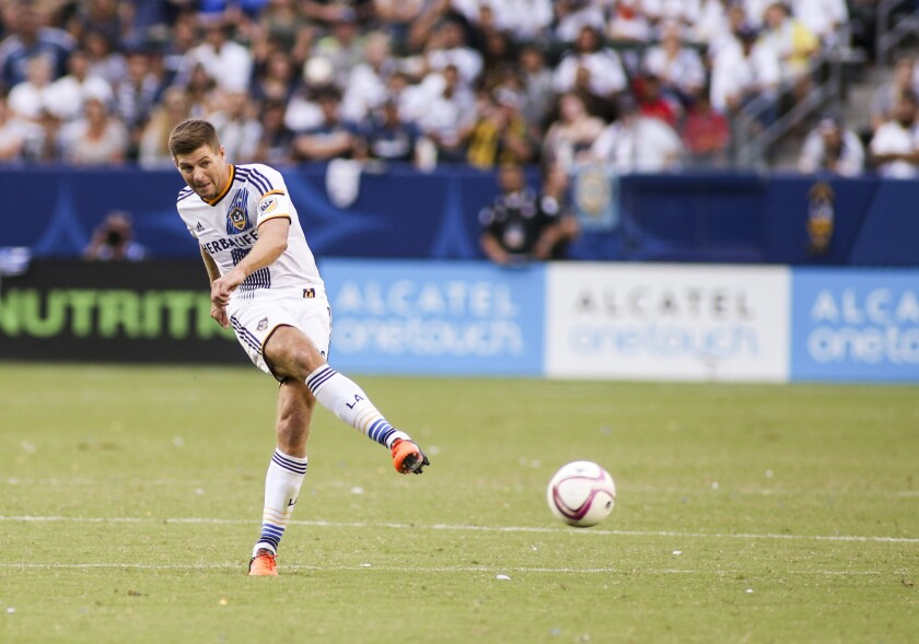 Galaxy midfielder Steven Gerrard sends the ball forward during a game against the Portland Timbers on Oct. 18.