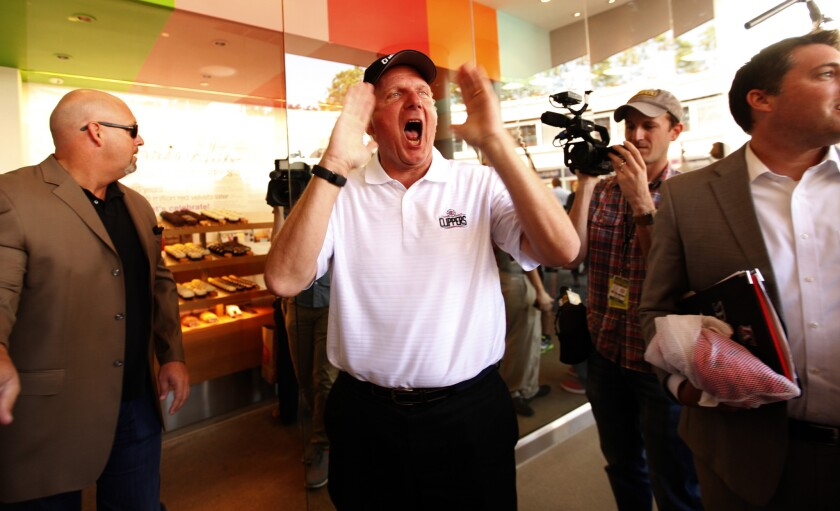 Clippers Owner Steve Ballmer shouts to fans at Sprinkles Cupcakes in downtown Los Angeles as part of his team's rebranding campaign and official launch of its new logos.