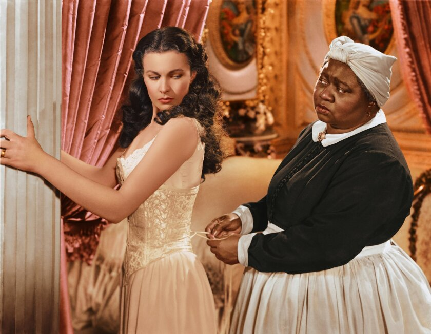 """In this image released by Turner Classic Movies, Vivien Leigh appears in character as Scarlett O'Hara, left, and Hattie McDaniel as Mammy, in the film, """"Gone with the Wind.""""  75 years after the premiere of the movie, Gone with the Wind, research is shedding light on the racial tensions that existed"""