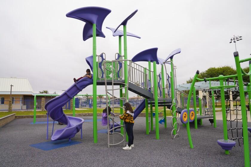 Siblings Corrina Bone, 10, Maria Bone, 5 and Vincent Bone, 7 enjoyed the large playground at Imperial Beach Sports Park.