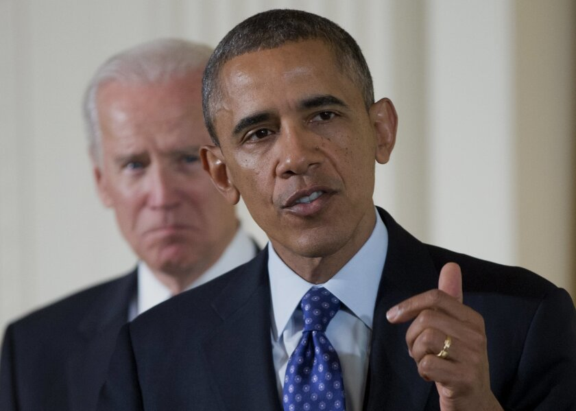 Vice President Joe Biden listens as President Barack Obama speaks in the East Room of the White House in Washington, Wednesday, Jan. 22, 2014, before the president signed a memorandum creating a task force to respond to campus rapes during an event for the Council on Women and Girls. (AP Photo/Caro