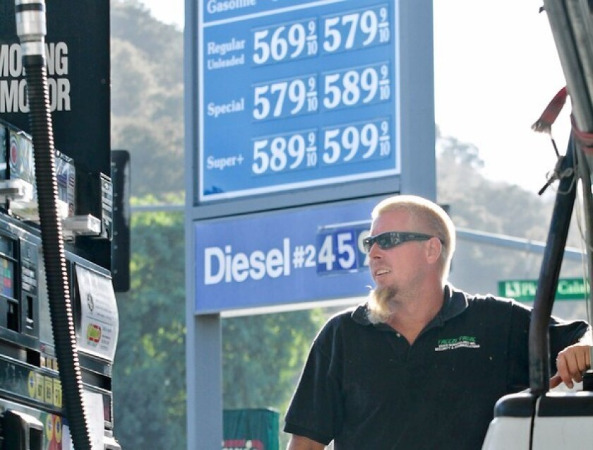 Oil companies scoff at the repeated charges of fuel price manipulation. Above, Dan Chandler fills his tank at a gas station in Calabasas on Friday.