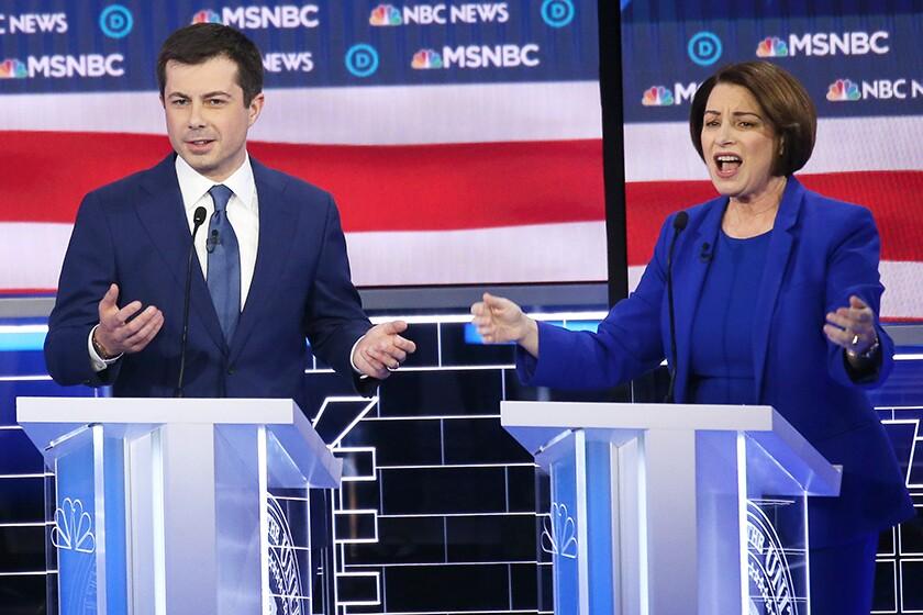 Democratic presidential candidates Pete Buttigieg and Amy Klobuchar spar verbally during Wednesday's debate in Las Vegas.
