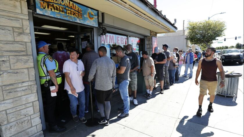 HAWTHORNE, CA-OCTOBER 19, 2018: People wait in line outside of Blue Bird Liquor in Hawthorne to buy