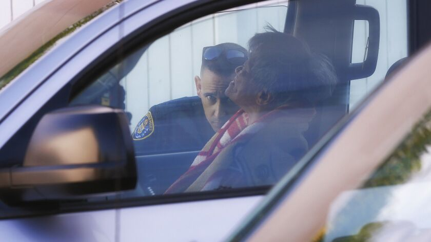 Responding to citizens call, Mark Erickson an officer with the SDPD Homeless Outreach Team makes con