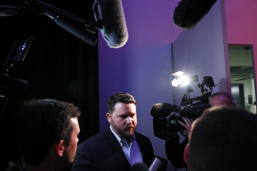 Iowa Democratic Party chairman Troy Price speaks to reporters about the delay in Iowa caucus results, Tuesday, Feb. 4, 2020, in Des Moines, Iowa. (AP Photo/Charlie Neibergall)