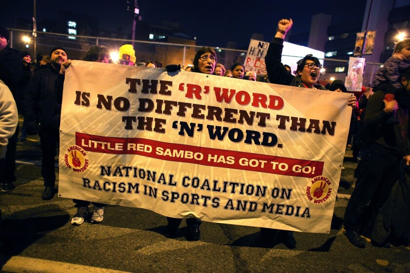 Native Americans protest before the Minnesota Vikings-Washington Redskins game in Minneapolis.