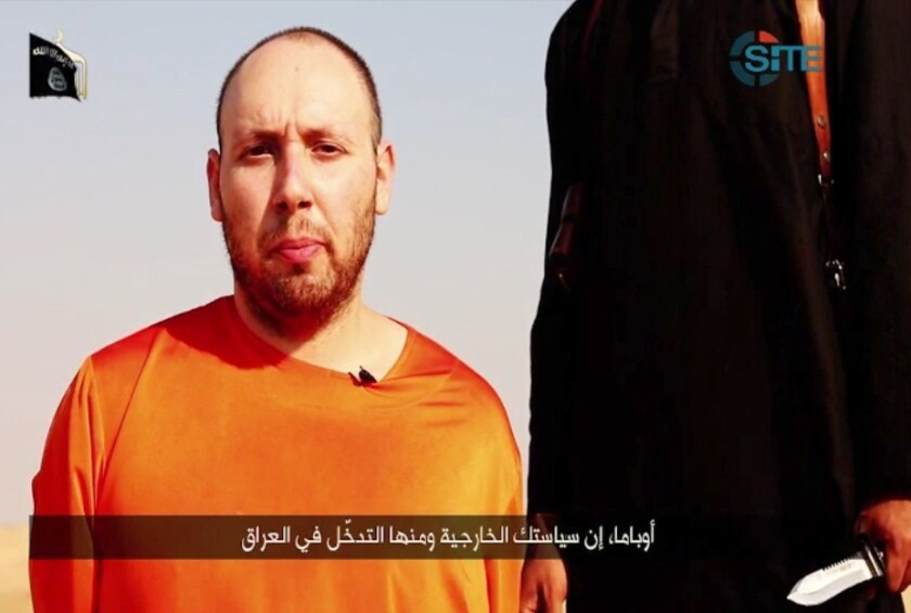 A video posted online Tuesday purports to show the killing of American journalist Steven J. Sotloff by Islamic State.