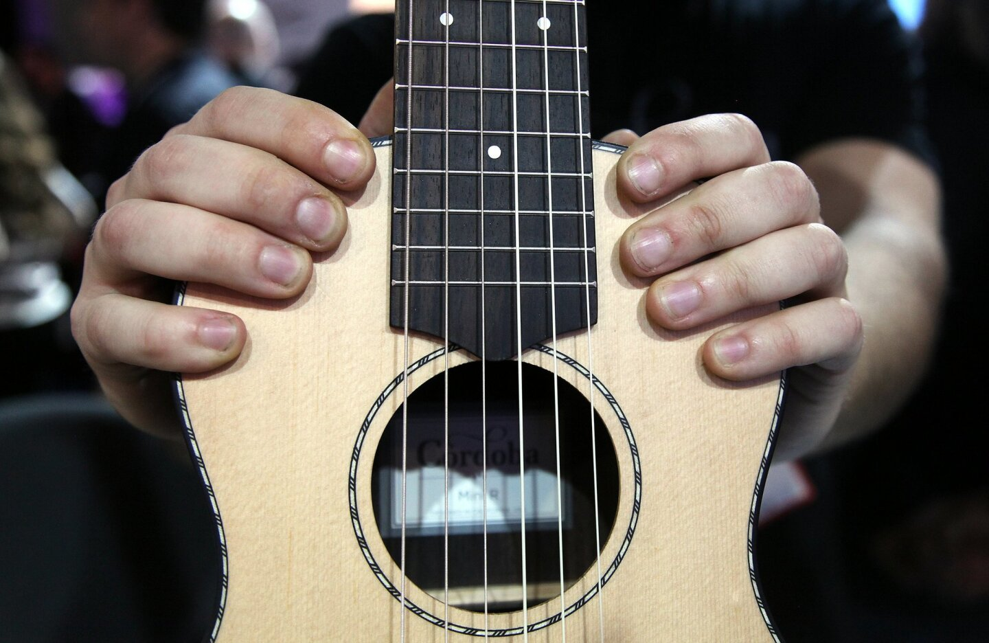 The Cordobo Mini Guitar is a small nylon-string guitar with the playability of a full-size guitar in a portable size.