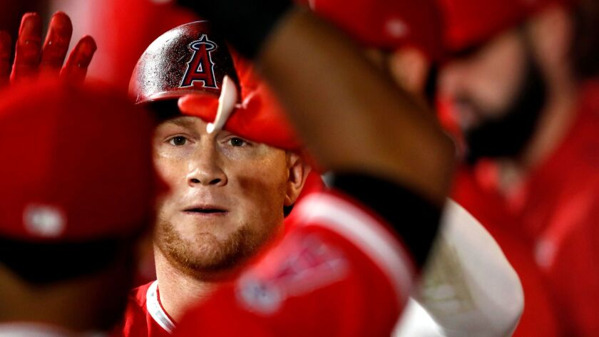epa06004867 Los Angeles Angels of Anaheim outfielder Kole Calhoun is welcomed to the dugout after hi