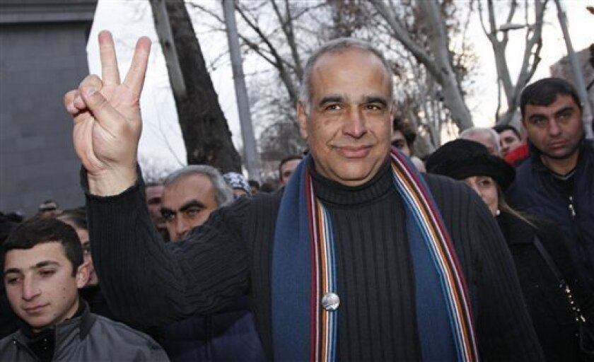 Presidential candidate Raffi Hovanessian gestures during a meeting with supporters in Yerevan, Armenia, Tuesday, Feb. 19, 2013. American-born Raffi Hovanessian, Armenia's first foreign minister after the 1991 collapse of the Soviet Union, on Tuesday called the election unfair and rigged, claiming c