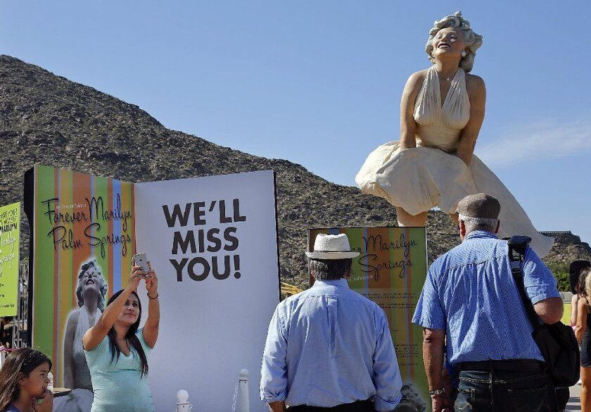 """Forever Marilyn,"" a statue by artist Seward Johnson, attracts fans of the late movie star in Palm Springs. The work is moving to New Jersey"