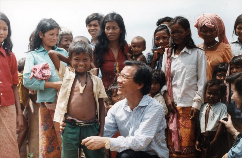 "Dr. Haing S. Ngor provides humanitarian aid to Cambodian refugees in ""The Killing Fields."""