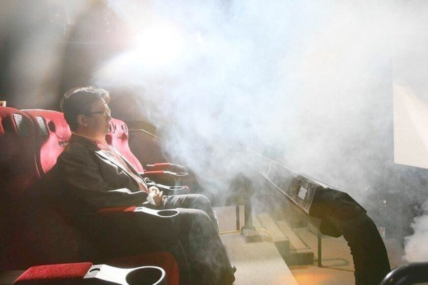 """Theodore Kim -- chief operating officer of the Los Angeles lab of theater operator CJ 4DPlex -- is hit with fog, one of the special effects the company creates for its """"4-D"""" moviegoing experience."""