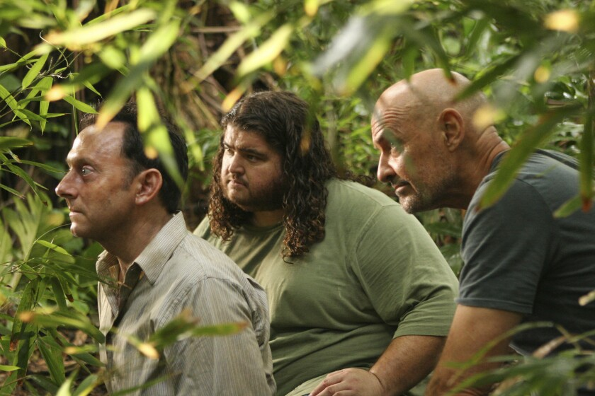 "Michael Emerson, left, Jorge Garcia and Terry O'Quinn in the jungle-like setting of ""Lost."""
