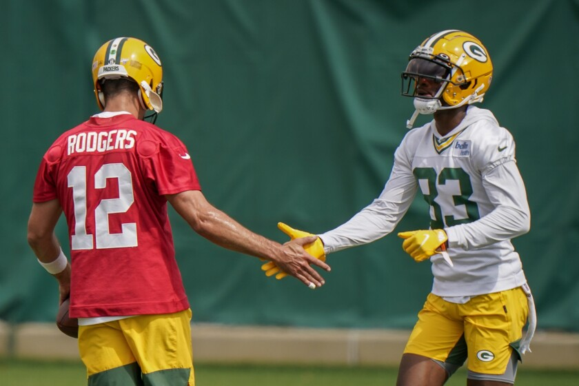 Green Bay Packers' Aaron Rodgers shakes hands with Marquez Valdes-Scantling during NFL football training camp Saturday, Aug. 15, 2020, in Green Bay, Wis. (AP Photo/Morry Gash)