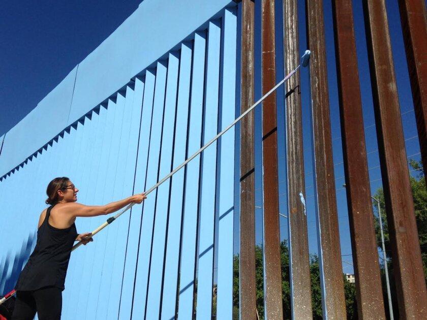 Artist Ana Teresa Fernandez painted part of the border wall blue as part of an art installation.