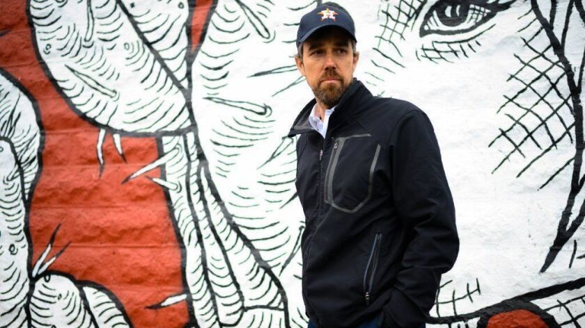 """Beto O'Rourke walks through El Paso's original shopping district, El Centro, in January 2019. He has acknowledged being """"in a funk"""" after his election loss in November."""