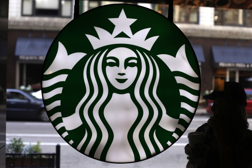 Starbucks joined more than a dozen other companies in a pledge to hire 100,000 young workers in the next three years
