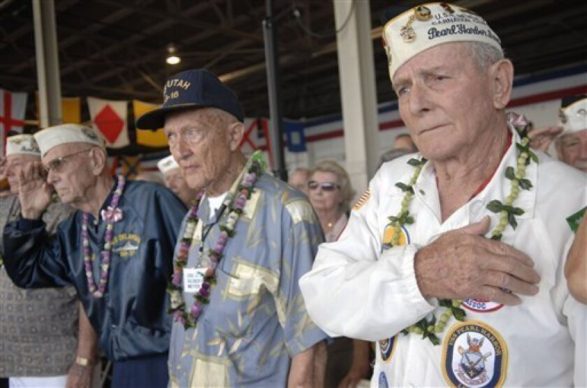 Woody Derby, 90, participates in a Pearl Harbor Commemoration in Pearl Harbor, Hawaii, Sunday, Dec. 7, 2008. With an eye on the immediate aftermath of the 1941 attack on Pearl Harbor, thousands of World War II veterans and other observers are expected on Sunday to commemorate the 67th anniversary of the devastating Japanese military raid. (AP Photo/Lucy Pemoni)