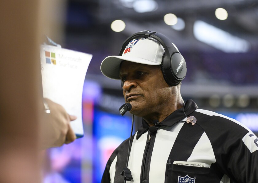 Referee Jerome Boger watches a replay during a game between the Oakland Raiders and Minnesota Vikings on Sept. 22.