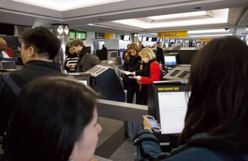 American Airlines last week unveiled a new fare structure that will allow coach passengers to dodge a $150 fee to change a booking if they pay up to $88 more for your ticket. Above, the airline's self-service kiosks at LaGuardia Airport in New York.