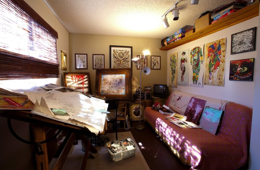 """Artist Dion Terry converted his apartment's second bedroom into a studio after growing tired of making a mess at the kitchen table. Among the items in the studio are a stuffed pheasant and a limited quantity of paint. """"Unfortunately, I'm a full-time artist. Paint is expensive."""""""