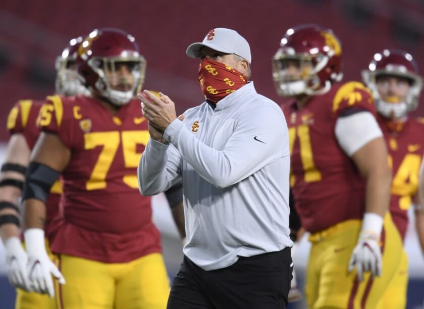 USC coach Clay Helton fires up his players before a game against Oregon.