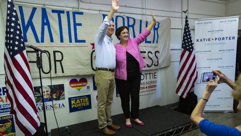 Rep. Adam Schiff (D-Burbank) and candidate Katie Porter greet the crowd during a rally at her campaign headquarters Tuesday in Tustin, Calif.
