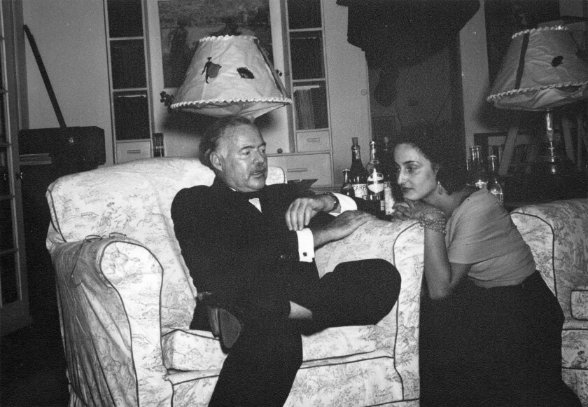 (L-R)- Ernest Hemingway and Adriana Ivancich sit in the living room at the Finca Vigia. Credit: Erne