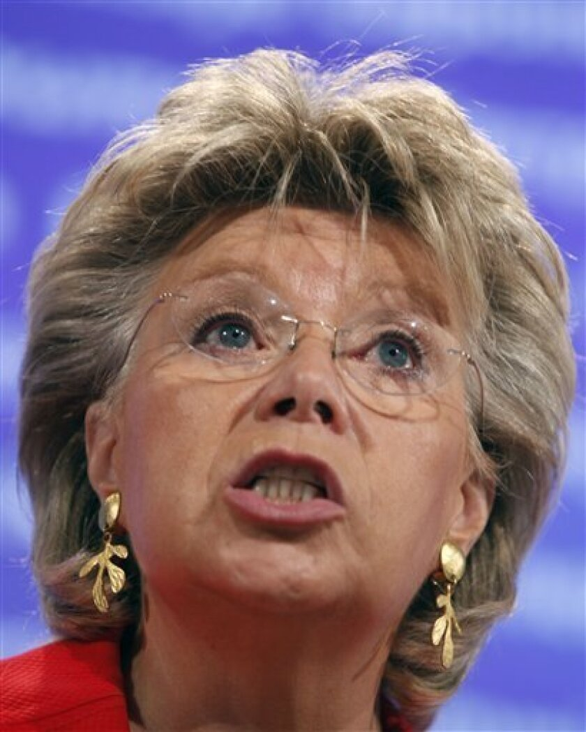 European Commissioner Vice President and Commissioner for Justice Viviane Reding speaks during a media conference at EU headquarters in Brussels, Tuesday, Sept. 14, 2010. Reding today threatened France with legal action over the mass expulsions of Roma. (AP Photo/Virginia Mayo)