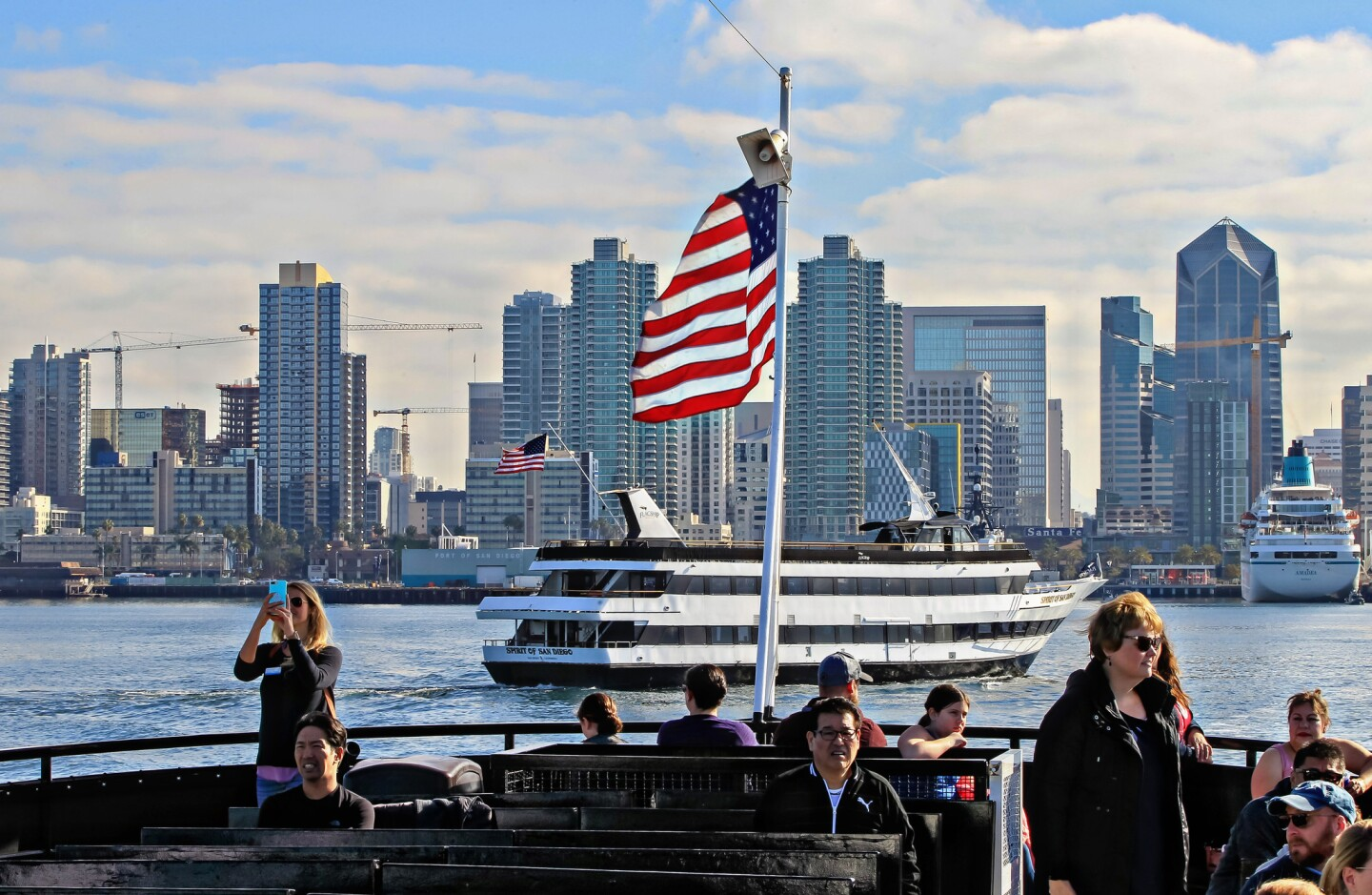 Passengers enjoy the skyline as they leave on a whale watching tour presented by Birch Aquarium and Flagship Cruises.