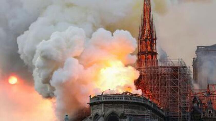 Flames and clouds of smoke coming off Paris' Notre-Dame cathedral, which was heavily damaged by the April 15 fire.
