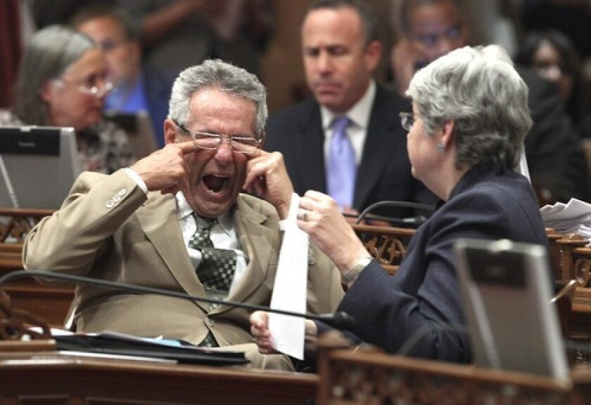 State Sen. Alan Lowenthal (D-Long Beach) rubs his eyes during an overnight legislative session in 2015.