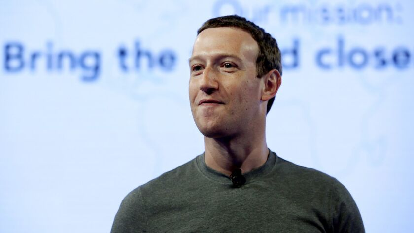 In this June 2017 photo, Facebook CEO Mark Zuckerberg speaks in Chicago. Zuckerberg embarked on a rare media mini-blitz Wednesday in the wake of a privacy scandal involving a data-mining firm.