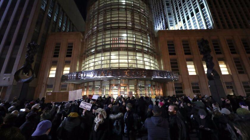 Demonstrators gather outside U.S. District Court in Brooklyn, N.Y., where a judge issued an emergency stay for those detained at airports under President Trump's executive action.