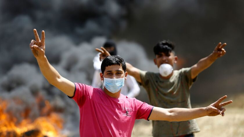 PALESTINIAN-ISRAEL-CONFLICT-GAZA-FEATURE-FACE MASKS