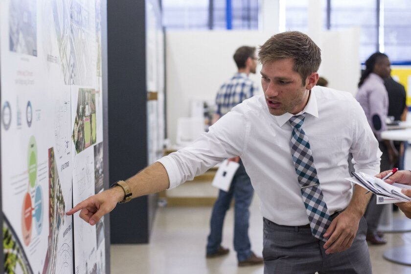 As of February, the biggest job growth category was professional and business services, which includes architectural services. Pictured: Architecture student Conor Brown at The New School of Architecture and Design shows his work at an open house in June 2016.